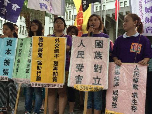 Groups for foreign spouses and workers gather in front of the headquarters of Taiwan