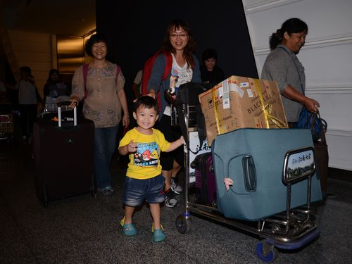 Taiwanese returning from Vietnam at Taiwan Taoyuan International Airport early Friday.