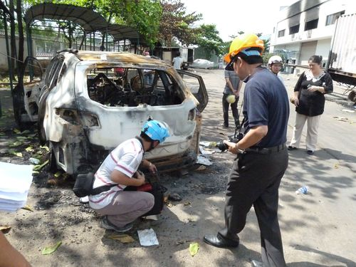 Vietnamese officials examine losses at a Taiwanese factory in the Southeast Asian country May 21.