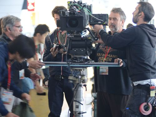 Director Luc Besson (second right) shoots scenes for