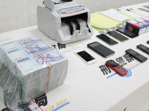 Cash, phones ans equipment seized in a raid of the fraud ring in 2015. (CNA file photo)