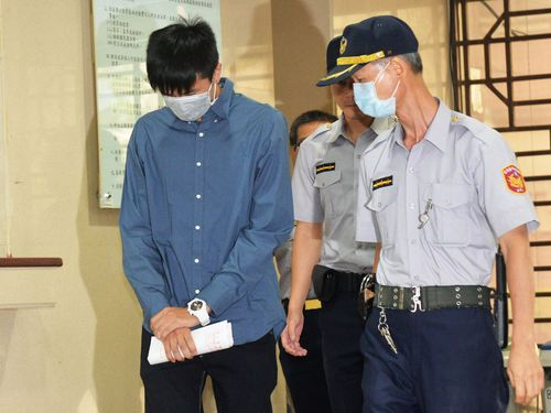 Chan Ho-yeung (left) arrives in the court building.