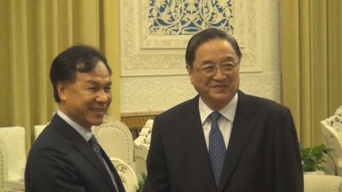 Lienchiang County Magistrate Liu (left) shakes hands with China