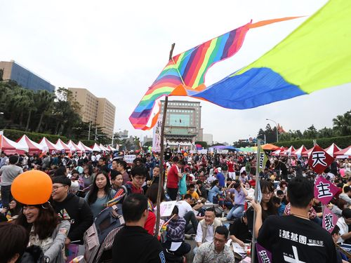 Some 200,000 people flock to a concert Saturday in downtown Taipei in support of legislation to legalize same-sex marriage.