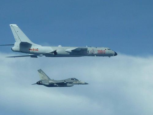 A Chinese Xian H-6K (top) bomber and a Taiwanese IDF fighter fly side by side in Taiwan