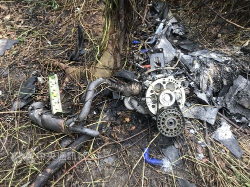 Burned out remnants of a Navy unmanned aerial vehicle (UAV) lay in a grass field in the southern county of Pingtung Thursday. The UAV crashed onto the field on the same day following a training exercise in the area.  Photo courtesy of Pingtung County Bureau of Fire and Emergency Services March 8, 2018