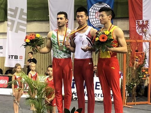 Taiwanese artistic gymnast Lee Chih-kai (李智凱, second right) / photo courtesy of Lin Yu-hsin (林育信)