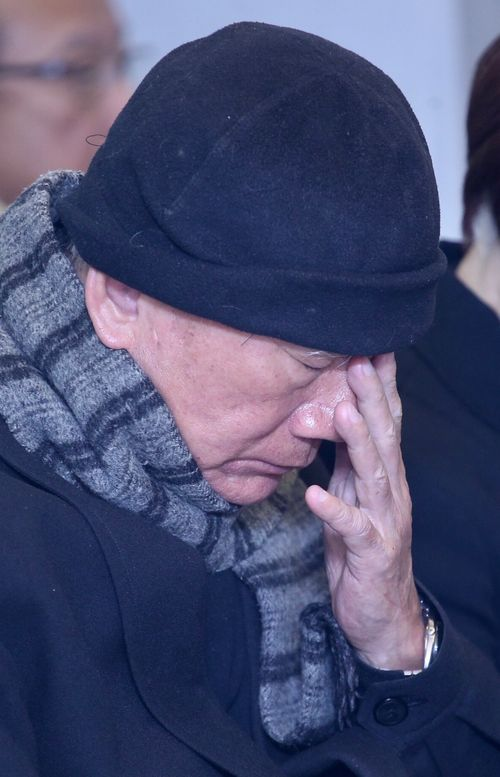 Former DPP Chairman Lin Yi-hsiung attends a memorial service in 2018 to remember his deceased mother and twin daughters (CNA file photo)