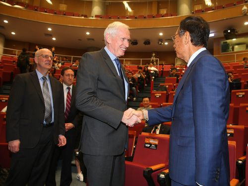 AIT Chairman James Moriarty (left) shakes hands with Hon Hai Precision Industry Co. founder Terry Gou.