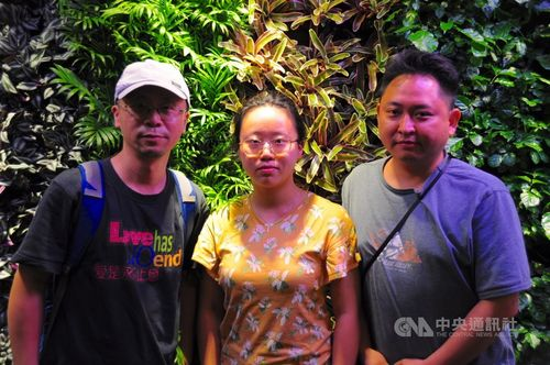 Church member Liao Qiang (left) and his family