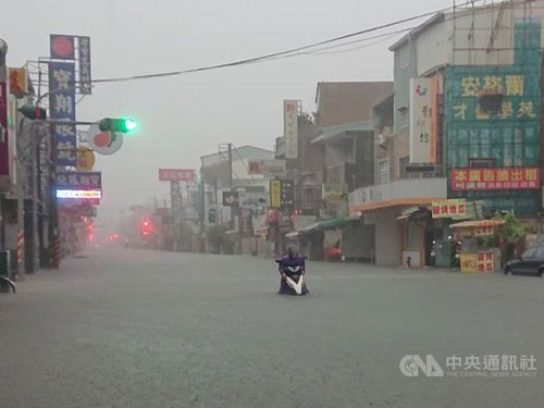 Motorcyclist in flooded road in Tainan