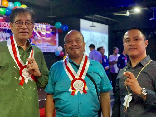 CIASI International Chairman Julius Magno (left), Nelson Palaris (center), assistant director for notarials at MECO, and CIASI Taiwan National Chairman Rheden Delumen (right)