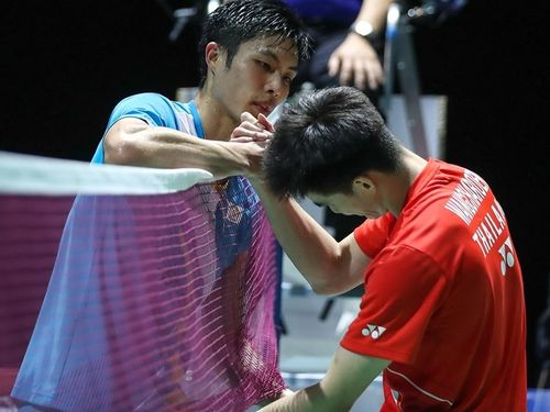 Taiwanese badminton player Chou Tien-chen (left) and Thailand
