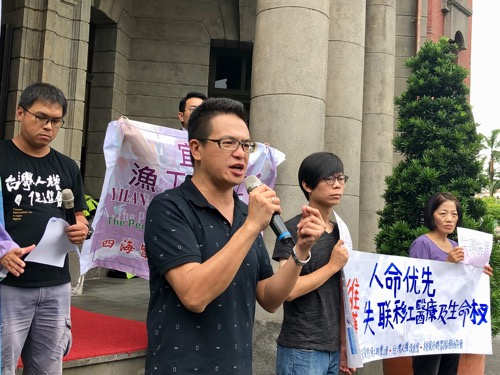 Lennon Ying-dah Wong (汪英達, front), director of the service center and shelter for migrant workers under the Serve the People Association in Taoyuan