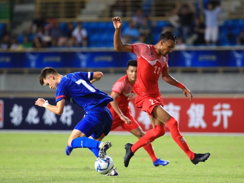 Taiwan midfielder Will Donkin (left) and Nepal midfielder Rohit Chand (right) / Photo courtesy of Chinese Taipei Football Association