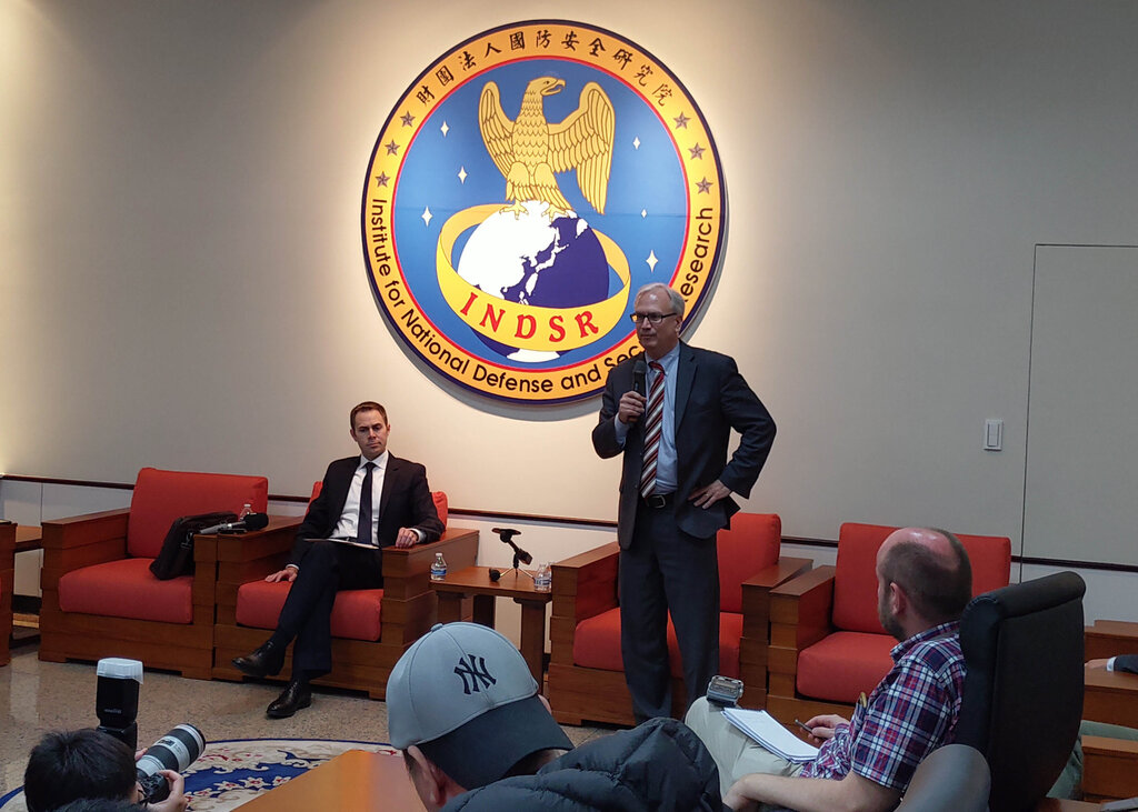 Michael Mazza (left, sitting) and Mark Stokes (right).