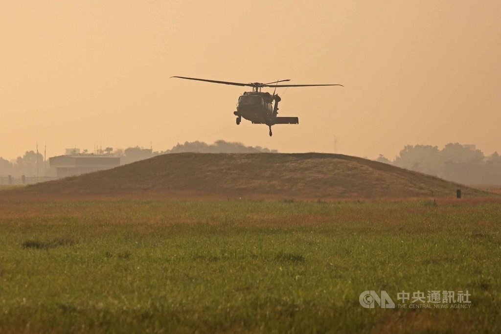 A Black Hawk helicopter flies over the Chiayi air base