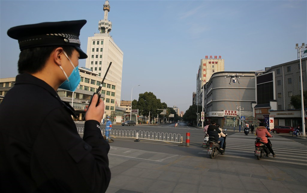 Chinese police officer broadcasts via a drone a call asking people to wear mask. Photo courtesy of the China News Service