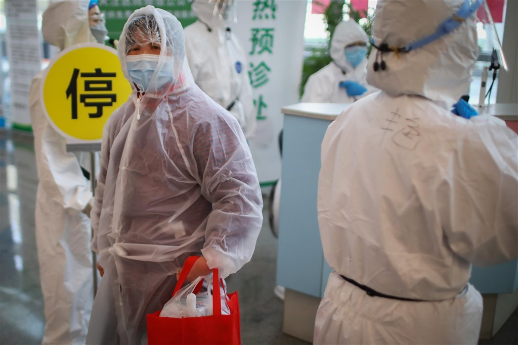 China: Almost all new infections outside Wuhan originated overseas