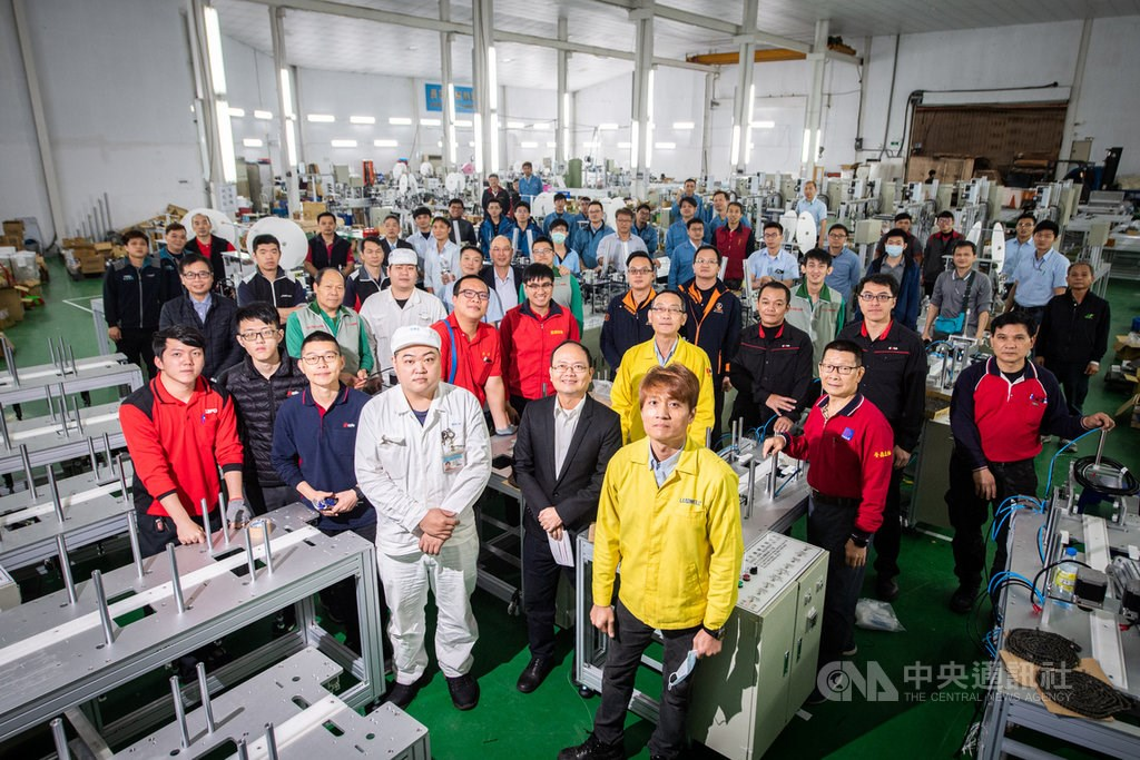 Engineers tasked with assembling mask production units at a factory in New Taipei.