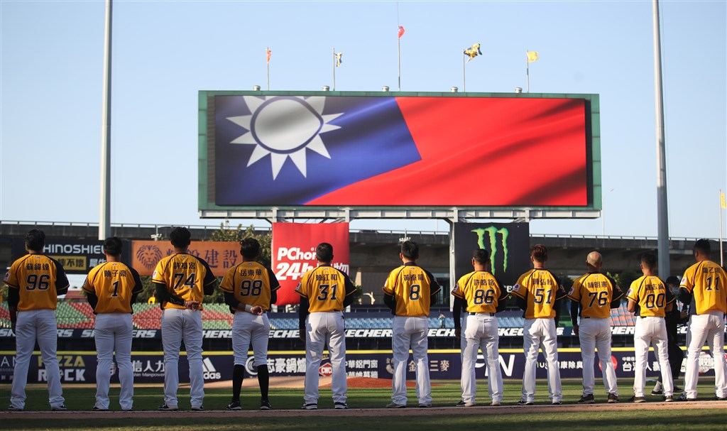 Home team Chinatrust Brothers sing the national anthem of Taiwan at Taichung Intercontinental Baseball Stadium. Taiwan is the first country in the world to start its baseball season amid the COVID-19 pandemic.