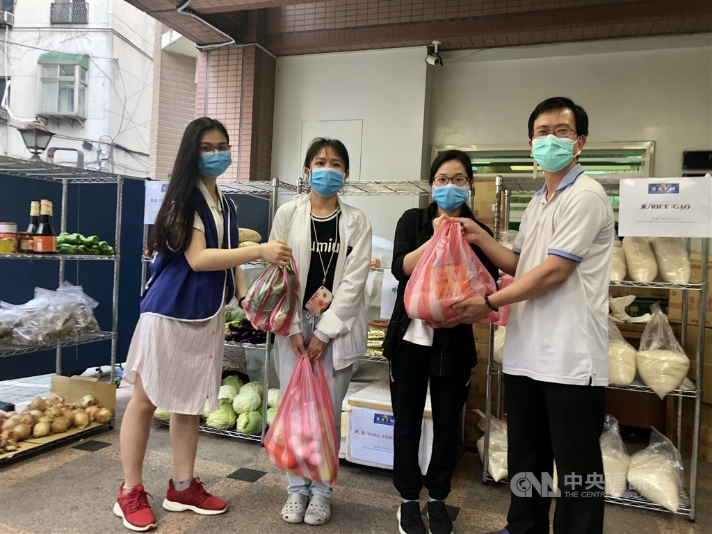 International students pick up free groceries at Saint Christopher