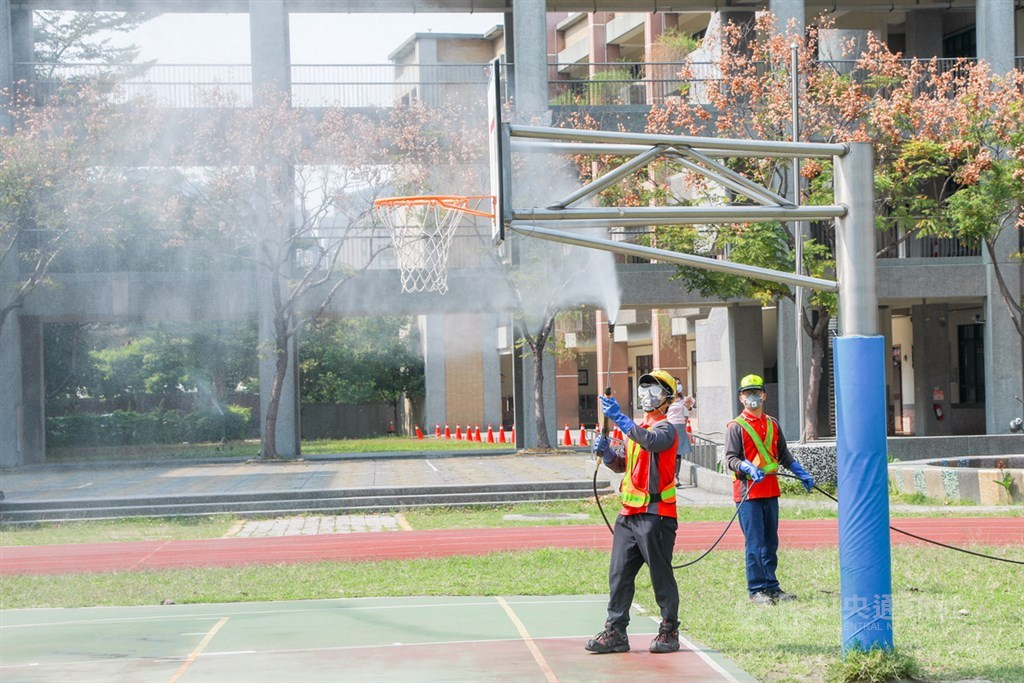 City government employees disinfecting school grounds/ CNA file photo