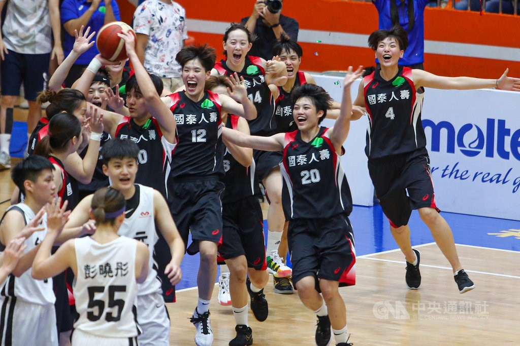 Cathay players (in black) celebrate the win. / CNA photo June 20, 2020