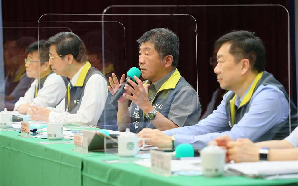 Health Minister Chen Shih-chung (center) speaks during the CECC