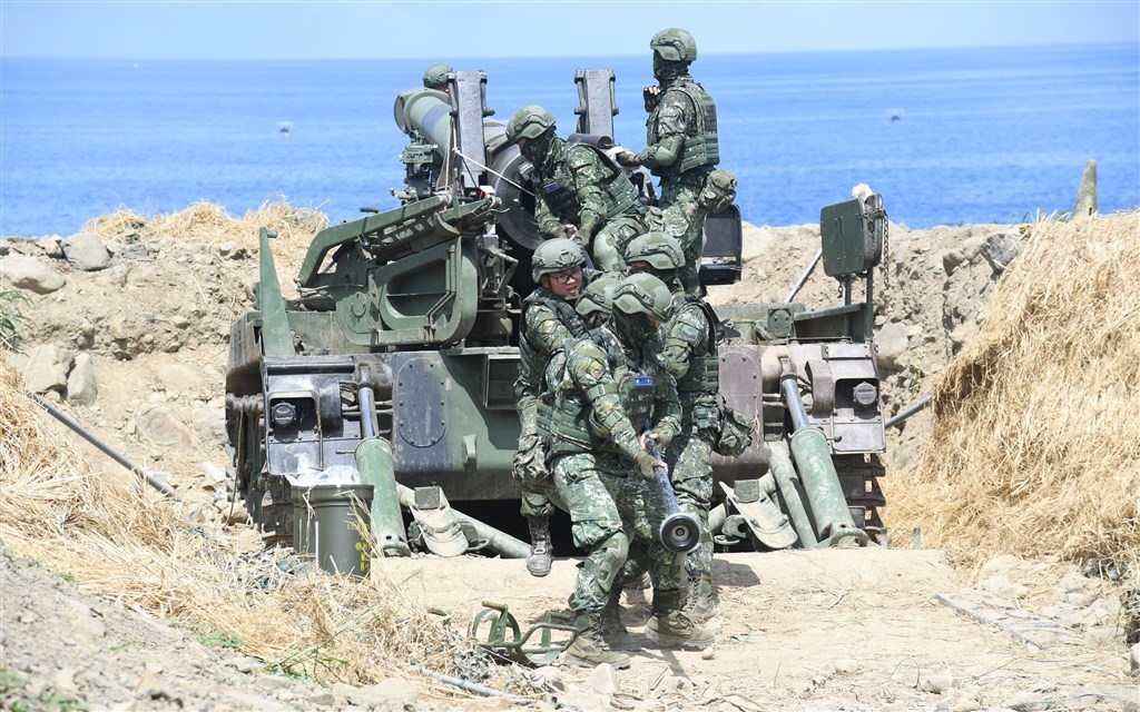 Soldiers load a cannon during 2019
