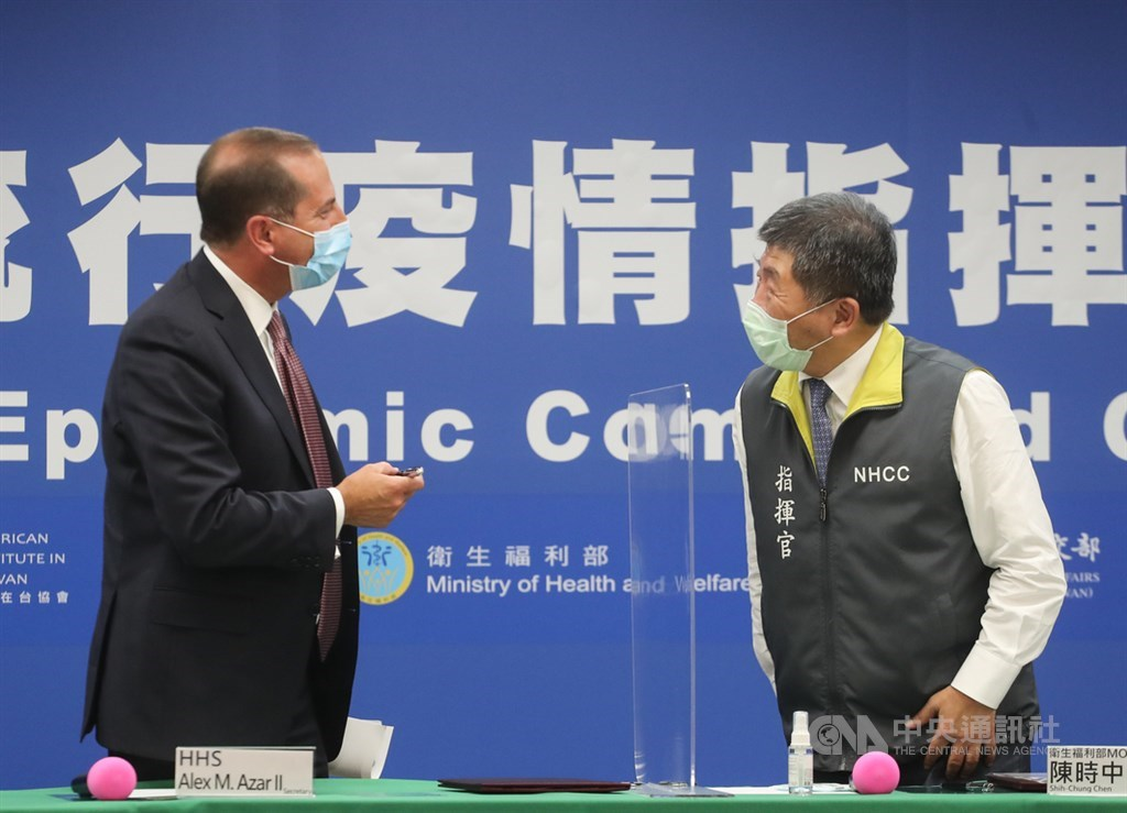 U.S. Health and Human Services Secretary Alex Azar greets Health Minister Chen Shih-chung ahead of Monday