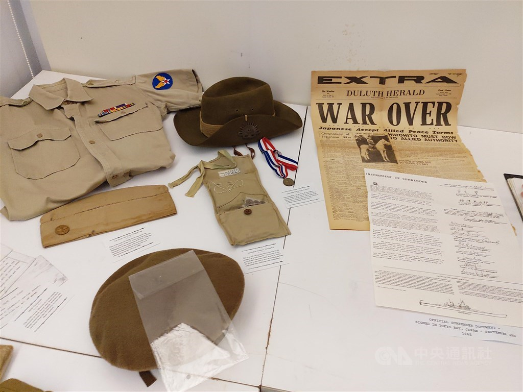 Some of WWII military and prisoner of war artifacts, collection of TPCMS director Michael Hurst, on display at the 13th Far East Prisoner of War Day event.