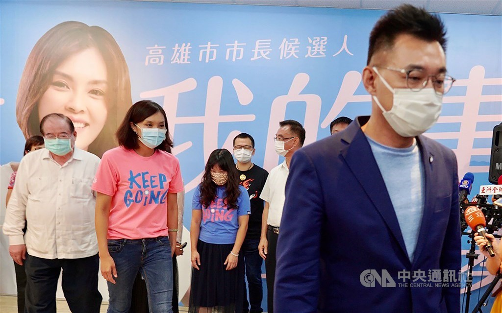 KMT Chairman Johnny Chiang (right) leaves the campaign headquarters after the party