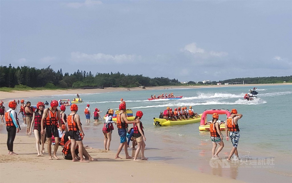 Visitors flock to a beach to Penghu County in August.