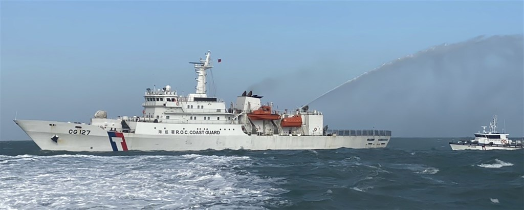 A Coast Guard vessel uses water canon to disperse Chinese ships. Photo courtesy of the Coast Guard Administration