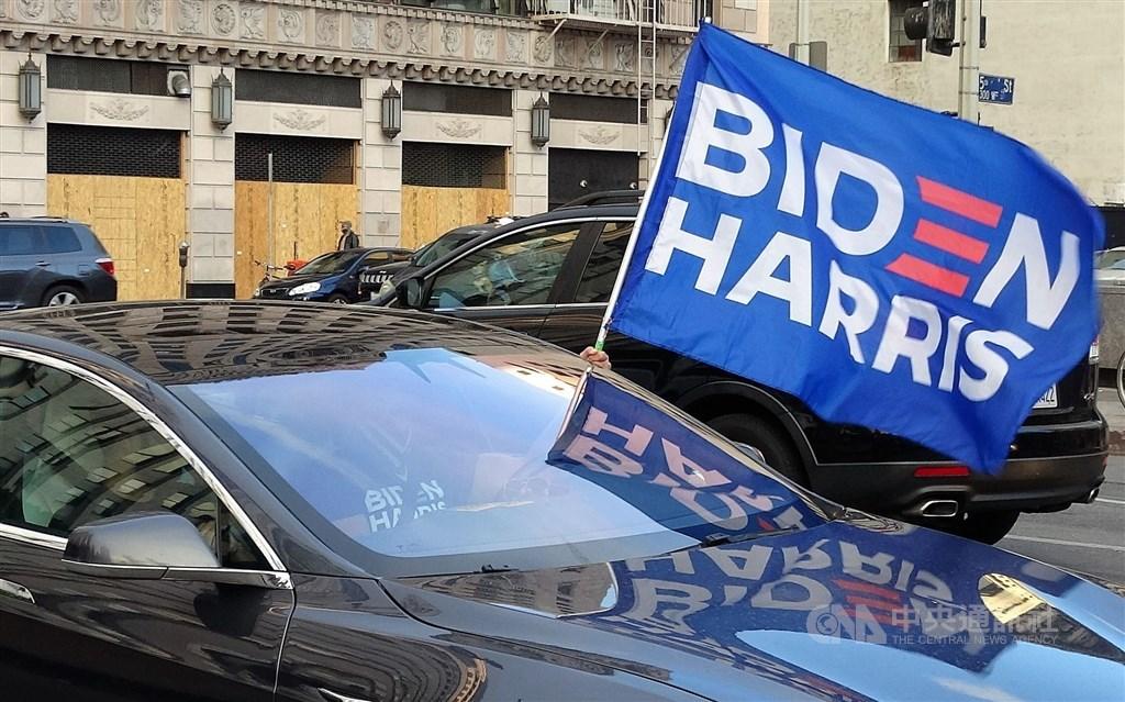A supporter for Joe Biden celebrates in Los Angeles Saturday. CNA photo Nov. 8, 2020