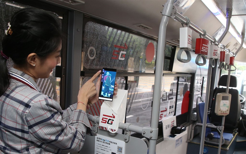 A model demonstrates the 5G service available on Taipei
