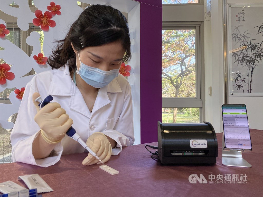 A researcher performs a demonstration of the rapid tester during a press event held Thursday / CNA photo Feb. 18, 2021