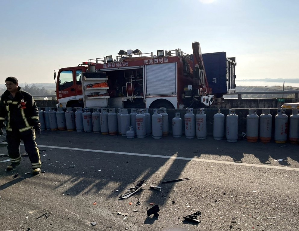 Firefighters line up liquefied petroleum gas tanks that had scattered after the accident. Photo courtesy of the Chiayi County Fire Bureau, Jan. 21, 2021