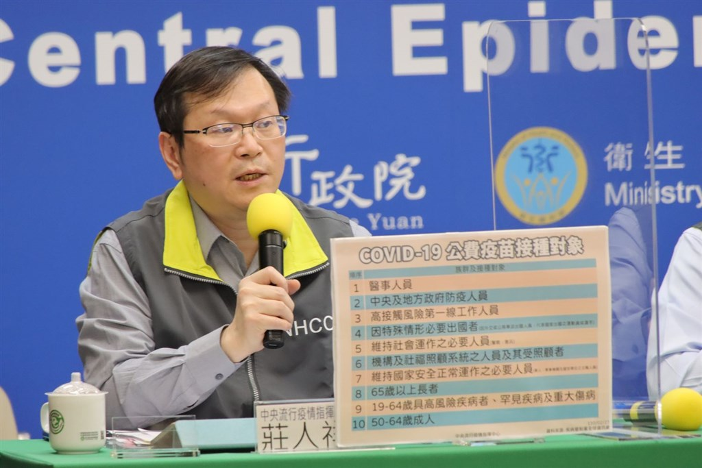 CECC spokesman Chuang Jen-hsian shows the list of 10 priority groups to receive vaccination in the government