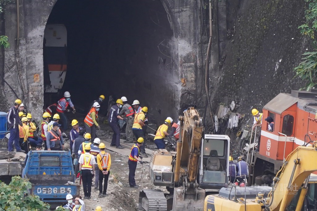Workers pulling out parts of the train stuck in the tunnel. CNA photo April 4, 2021