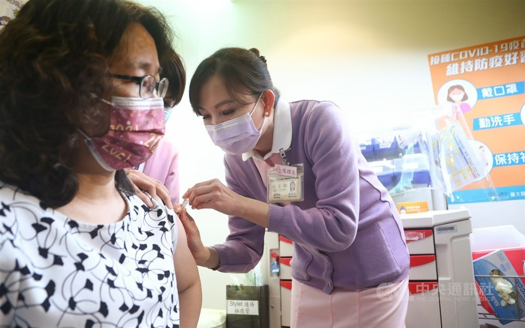 A woman receives the COVID-19 vaccine when Taiwan began the rollout of the vaccination March 22. CNA file photo