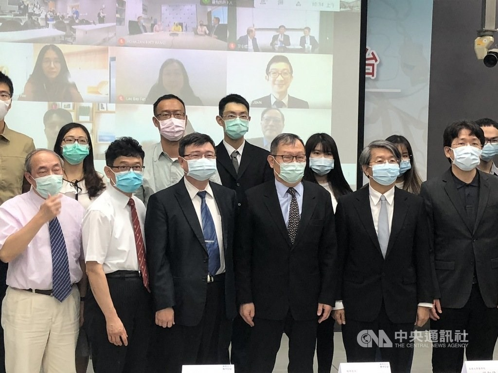 Members of the research team pose for a group photo during a press event held Friday. CNA photo April 30, 2021