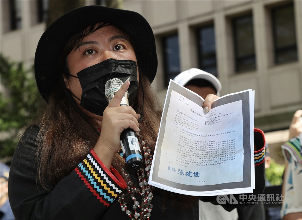 One of the advocates voices their call outside the Ministry of the Interior in Taipei Wednesday. CNA photo May 12, 2021