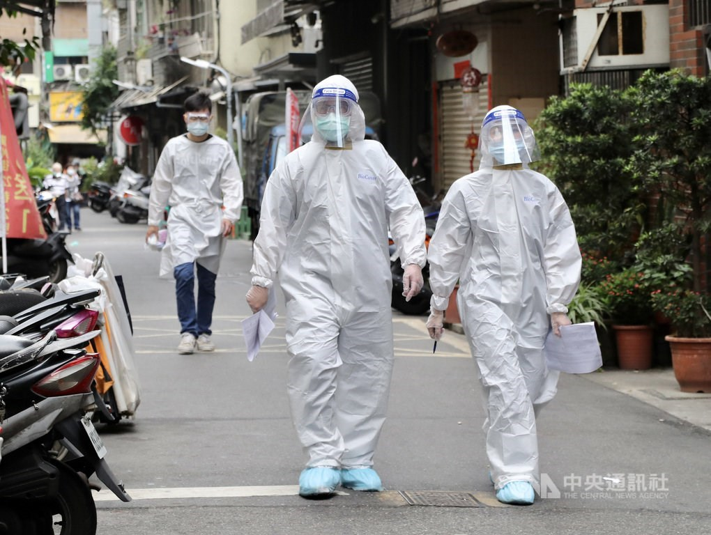 Health workers carry out disinfection across the various establishments in Taipei