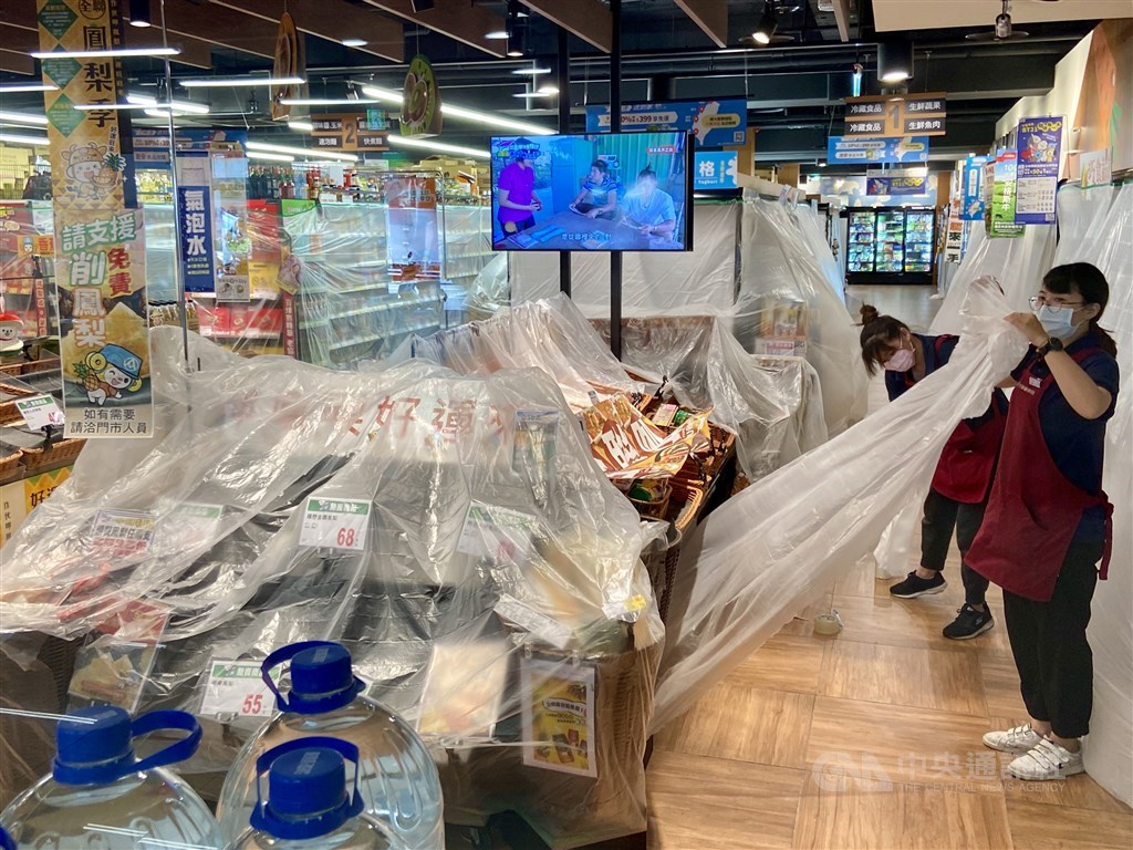 Workers at the supermarket prepare the store for disinfection on Friday. CNA photo May 14, 2021