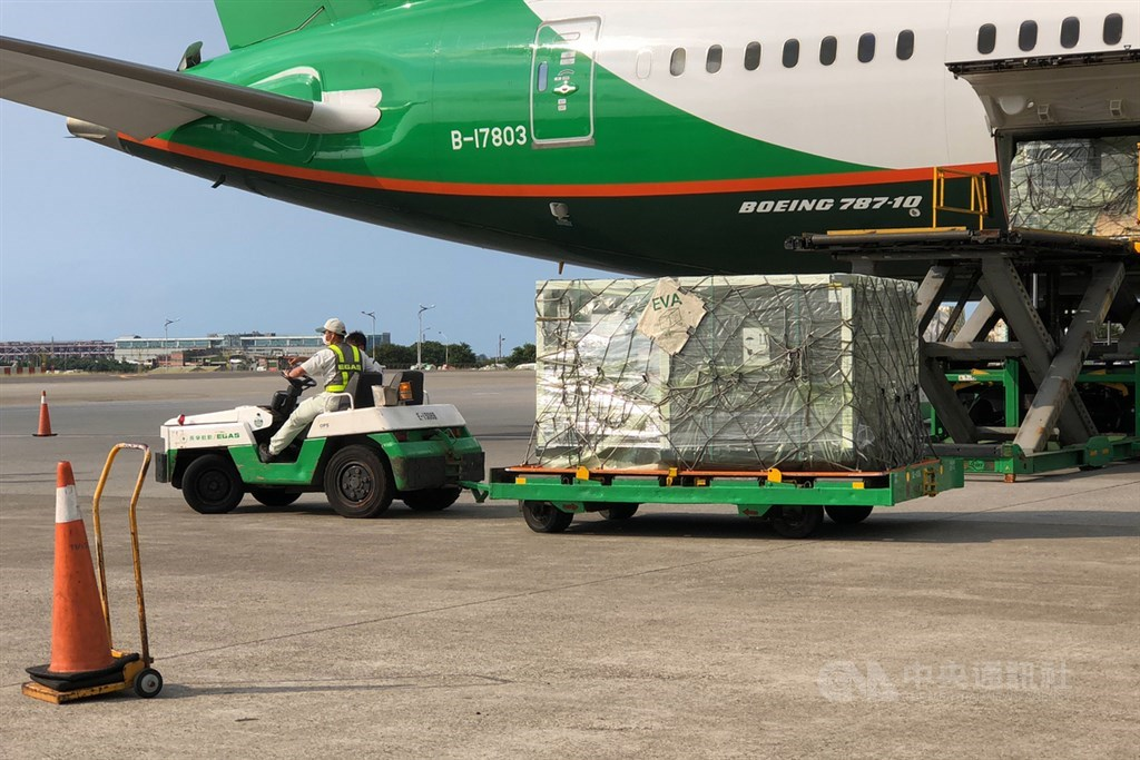 The vaccines are offloaded from an EVA Airways plane. CNA photo May 19, 2021