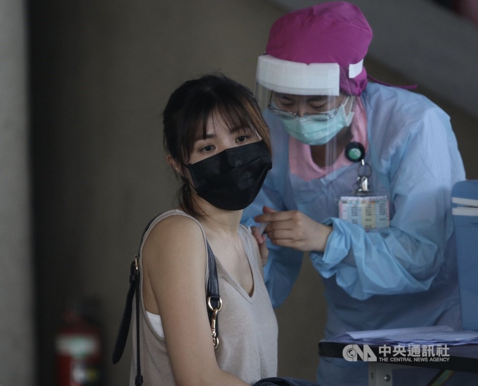 CNA file photo showing a woman receiving a COVID-19 vaccine.