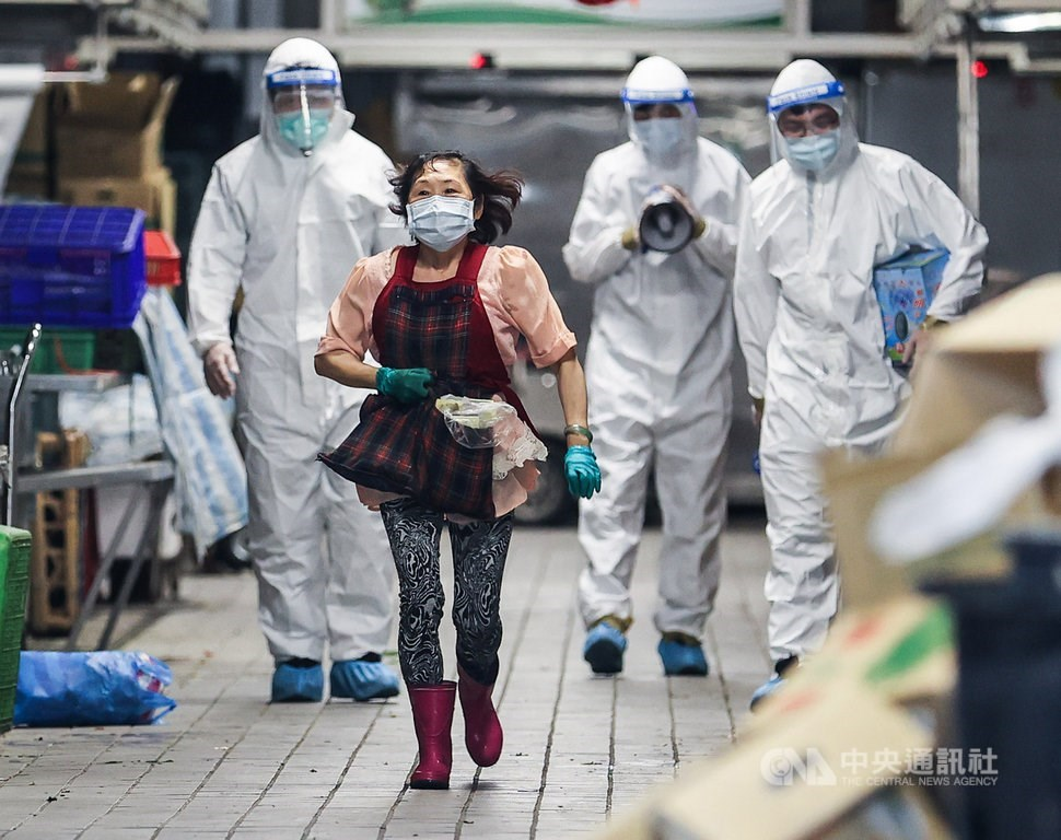 Disinfection workers at the Huannan Market in Taipei
