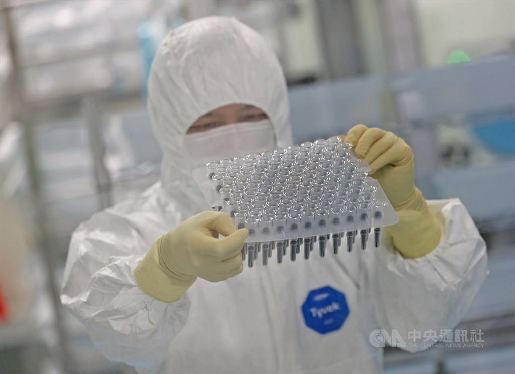 A Medigen worker examines packaging of the company